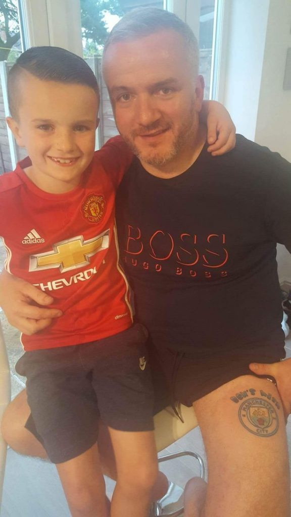 Manchester-United-fan-gets-City-tattoo-to-help-raise-money-for-best-friends-son