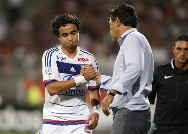 LYON - AUGUST 9: Rafael da Silva of Lyon greets coach of Lyon Hubert Fournier after being replaced during the French Ligue 1 match between Olympique Lyonnais (OL) and FC Lorient at Stade de Gerland on August 9, 2015 in Lyon, France. (Photo by Jean Catuffe/Getty Images)